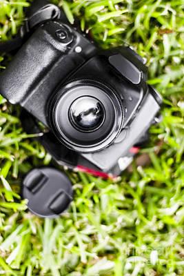Digital Slr Camera On Green Grassy Field Poster by Jorgo Photography - Wall Art Gallery