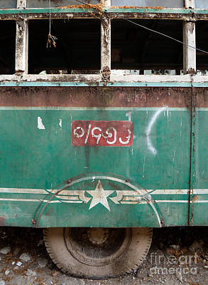 Dilapidated Vintage Green Bus In Burma - Side View With Tire Poster