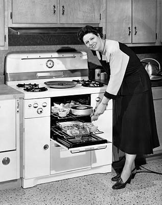 Dinner In The Oven Poster by Underwood Archives