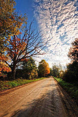 Poster featuring the photograph Dirt Road And Sky In Fall by Lars Lentz