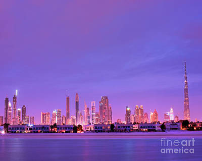 Dubai City Skyline From Emirates Towers To Burj Kalifa Aka Burj Dubai From Jumeirah Beach At Night Poster by Chris Smith