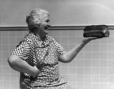 Elderly Woman Admiring Loaf Of Bread Poster by H. Armstrong Roberts/ClassicStock