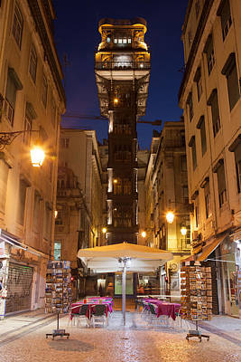 Elevador De Santa Justa In Lisbon By Night Poster by Artur Bogacki