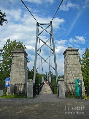 Entrance To Suspension Bridge Poster by John Malone