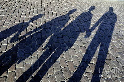 Family Of Four Casting Shadows On Cobbled Stone Street Poster by Sami Sarkis