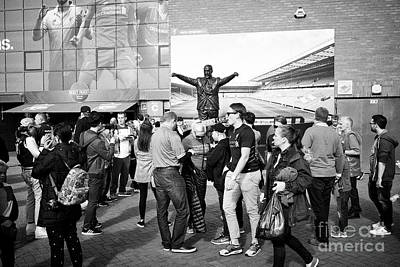 fans at the bill shankley statue at Liverpool FC anfield stadium Liverpool Merseyside UK Poster