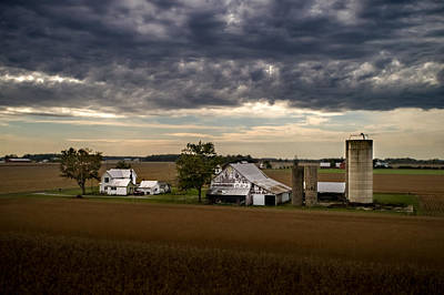 Farmstead Under Clouds Poster