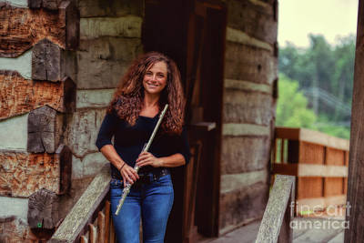Female Flute Player At Log Cabin Poster by Dan Friend
