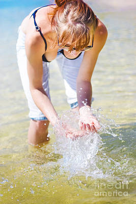 Female Traveler Playing In Shallow Water Poster by Jorgo Photography - Wall Art Gallery