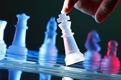 Finger Tilting A Chess Piece On Chess Board Poster by Jun Pinzon