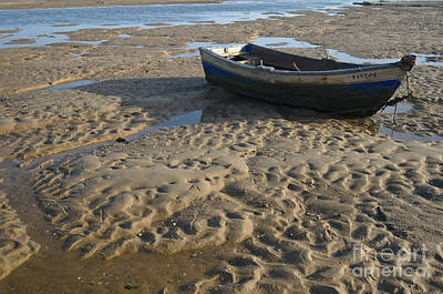 Fishing Boat Resting On The Beach Sand Poster