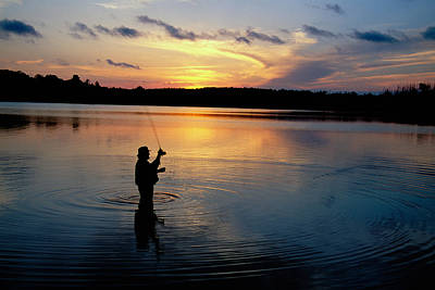 Fly-fisherman Silhouetted By Sunrise Poster