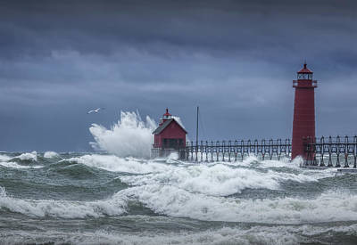 Flying Gull In A November Storm On Lake Michigan By The Grand Haven Lighthouse Poster by Randall Nyhof