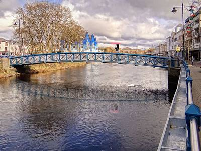 Footbridge Over The Garavogue River In Sligo With Reflections And Swans Sheltering Beneath It Poster