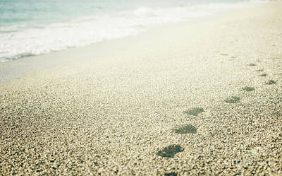Footprints On The Beach Poster