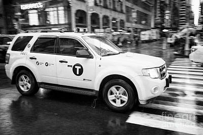 ford escape hybrid suv new york yellow taxi cab crossing times square in the rain New York City USA Poster