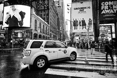 ford escape hybrid suv new york yellow taxi cab on crossing times square in the rain New York City U Poster