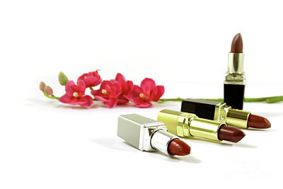 Four Lipsticks And Flowers Isolated On White Poster