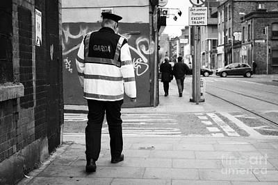 garda sergeant on foot patrol beat in dublin Ireland Poster by Joe Fox