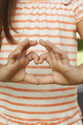 Girl Making Heart Shape With Fingers Poster