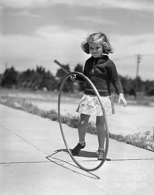 Girl Playing With Hoop And Stick Poster