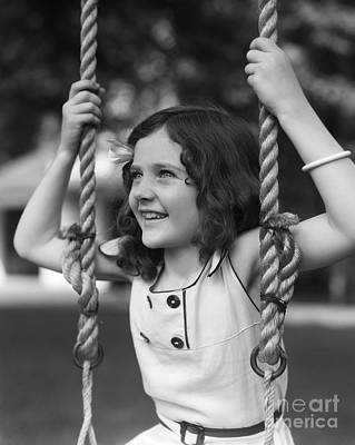 Girl Sitting On A Swing, C.1930s Poster by H. Armstrong Roberts/ClassicStock