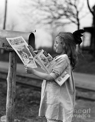 Girl Taking Magazines From Mailbox Poster by H. Armstrong Roberts/ClassicStock