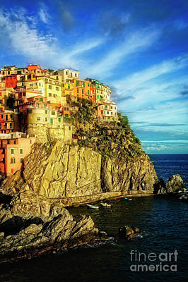 Poster featuring the photograph Glowing Manarola by Scott Kemper
