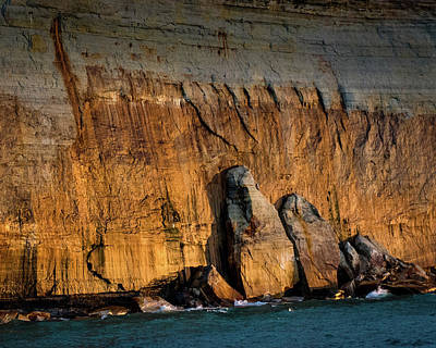 Golden Light On The Pictured Rocks. Poster