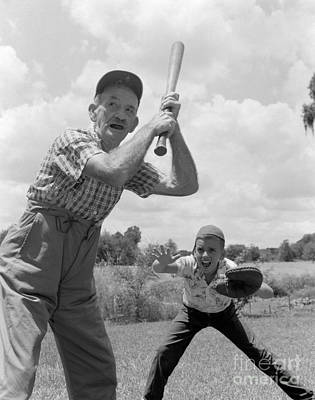 Grandfather At Bat With Boy As Catcher Poster by Debrocke/ClassicStock