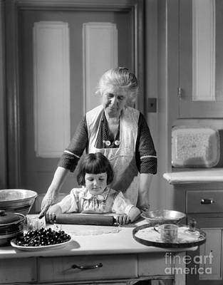 Grandmother And Granddaughter Baking Poster by H. Armstrong Roberts/ClassicStock