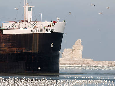 Great Lakes Ship Passing A Frozen Cleveland Lighthouse Poster