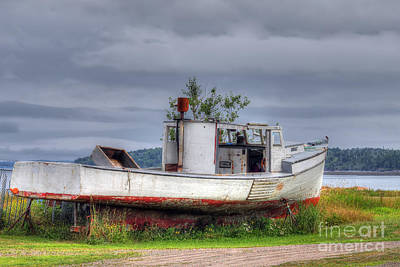 Grounded Fishing Boat Poster by Rick Mann