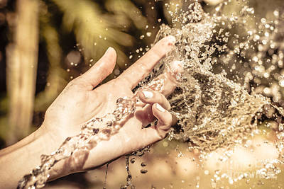 Hand Of A Woman Catching Water Stream Poster by Jorgo Photography - Wall Art Gallery