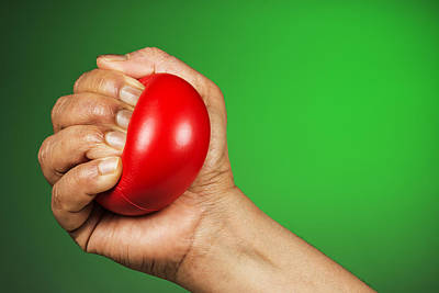Hand Squeezing Red Stress Ball Poster by Vishwanath Bhat