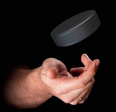 Hand Tossing Hockey Puck Poster