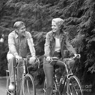Happy Mid-aged Couple On Bikes, C.1970s Poster by Photo Media/ClassicStock