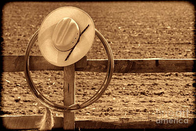 Hat And Lasso On A Fence Poster