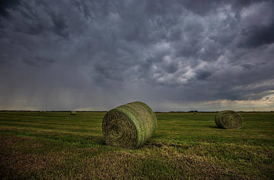 Hay Bales And Rain  Poster by Aaron J Groen