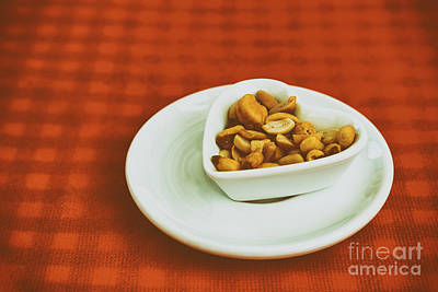 Heart Shaped Bowl With Dried Hard Fruits And Peanuts Poster by Radu Bercan