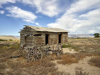 Historic Cabin And Buckboard Wheels In Big Horn County In Wyoming Poster