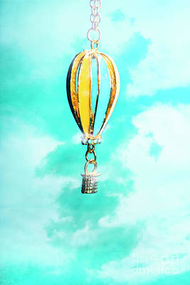 Hot Air Balloon Pendant Over Cloudy Background Poster