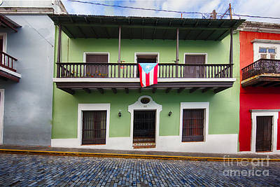 House With A Balcony And A Flag In Old San Juan Poster by George Oze