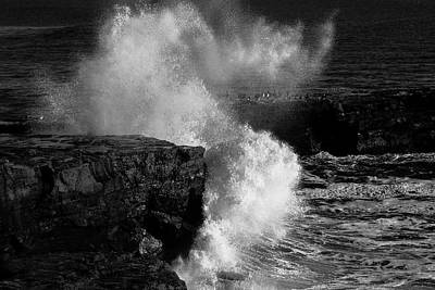 Huge Wave Breaking On The Rocks Poster