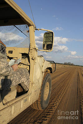 Humvee Driving Down A Dirt Road Poster