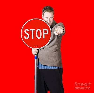 Isolated Man Holding Red Traffic Stop Sign Poster by Jorgo Photography - Wall Art Gallery