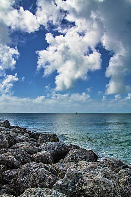 Poster featuring the photograph Key West Clouds On The Rocks by Bob Slitzan
