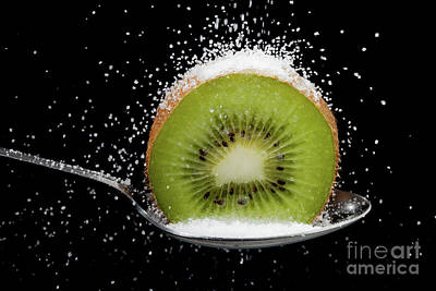 Kiwi Fruit Cut In Half On A Spoon With Sugar Poster