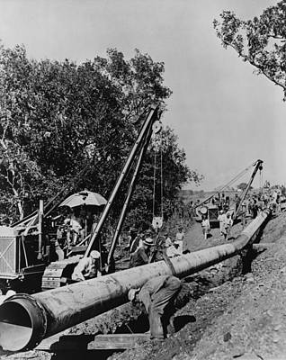 Laborers Laying Pipeline, To Carry Oil Poster by Everett