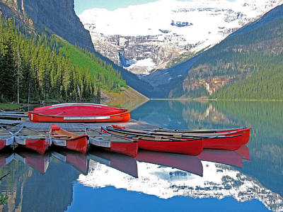 Poster featuring the photograph Lake Louise Canoes by Gerry Bates